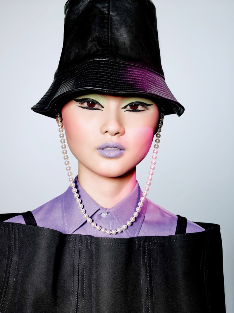 Model He Cong looks pretty in lavender with green eyeshadow
