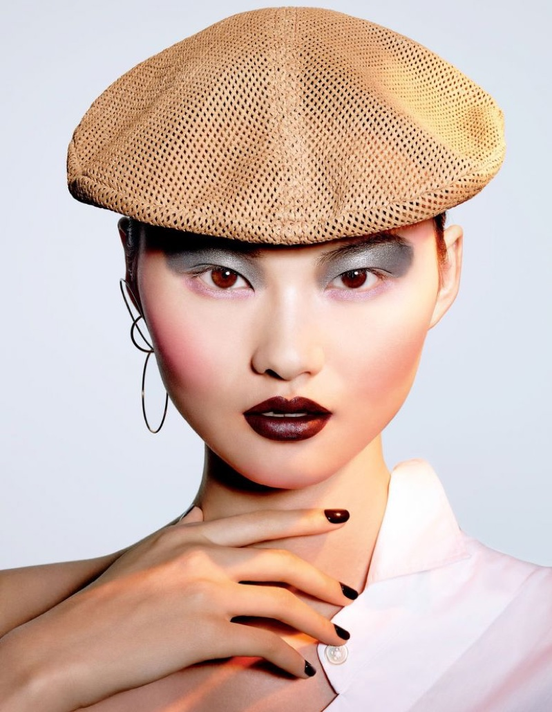 He Cong wears chocolate brown lipstick shade with matching manicure