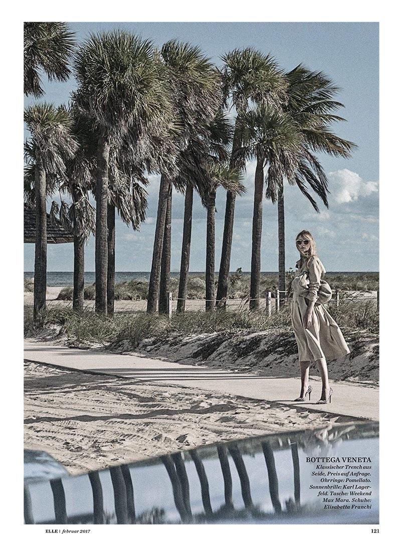 Posing near palm trees, Heather Marks wears Bottega Veneta trench with Elisabetta Franchi shoes