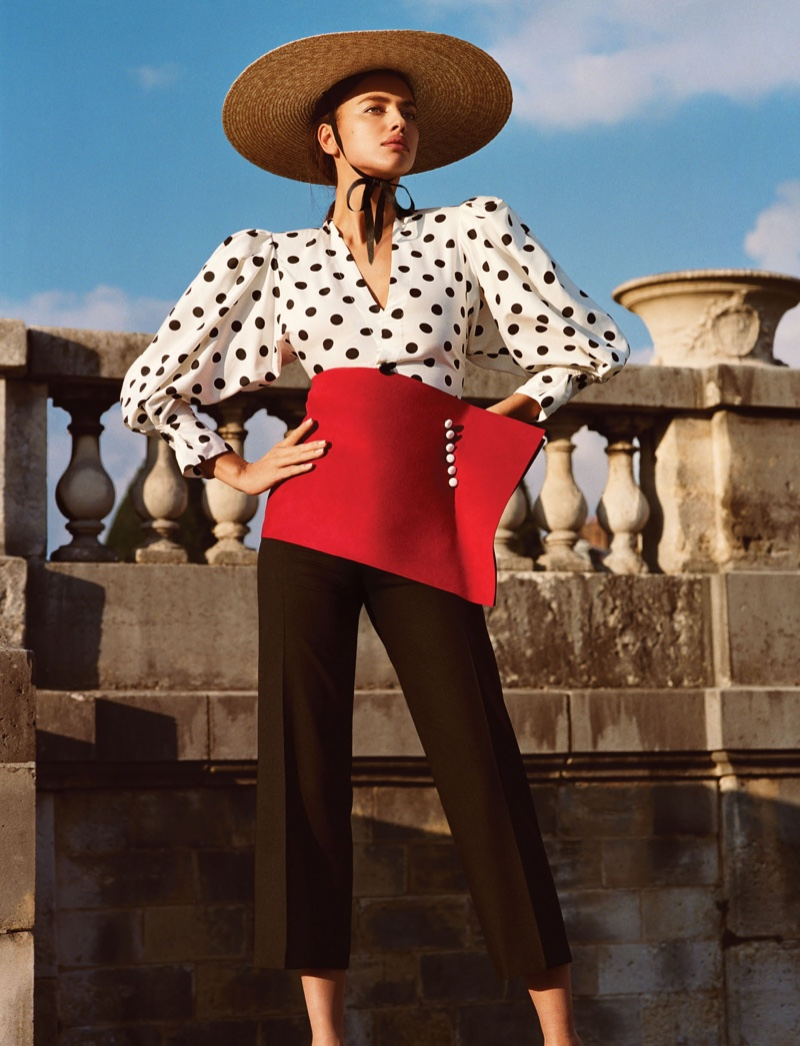Wearing polka dot prints, Irina Shayk poses in Jacquemus blouse, pants, hat and belt