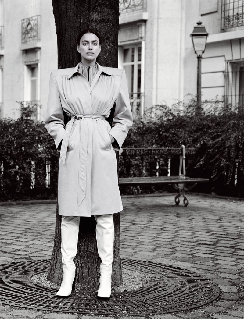 Irina Shayk embraces bold shoulders in Balenciaga trench coat, top and boots