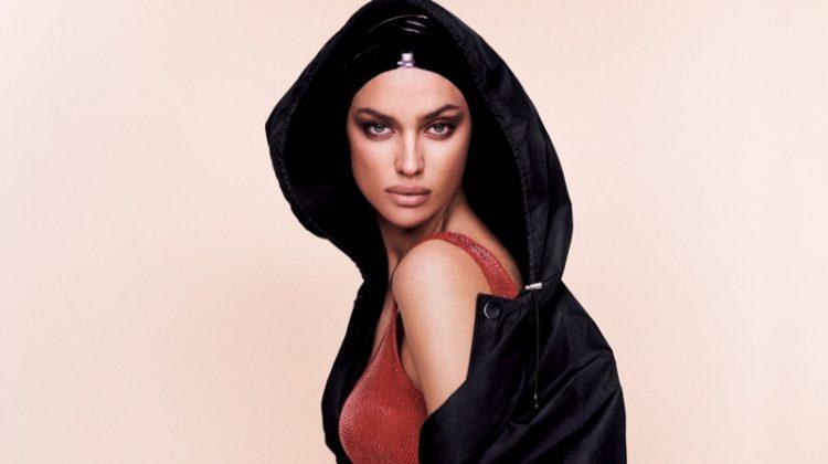Model Irina Shayk flaunts some leg in hooded parka and knit bodysuit