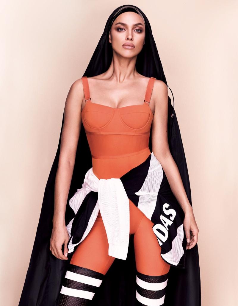 Model Irina Shayk poses in Max Mara bodysuit with adidas Originals jacket