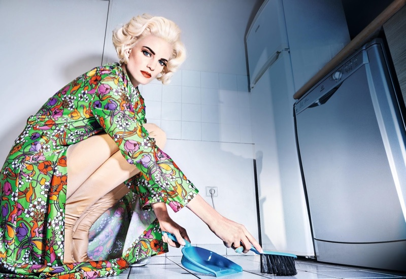 The model poses in floral prints for a housewife inspired editorial