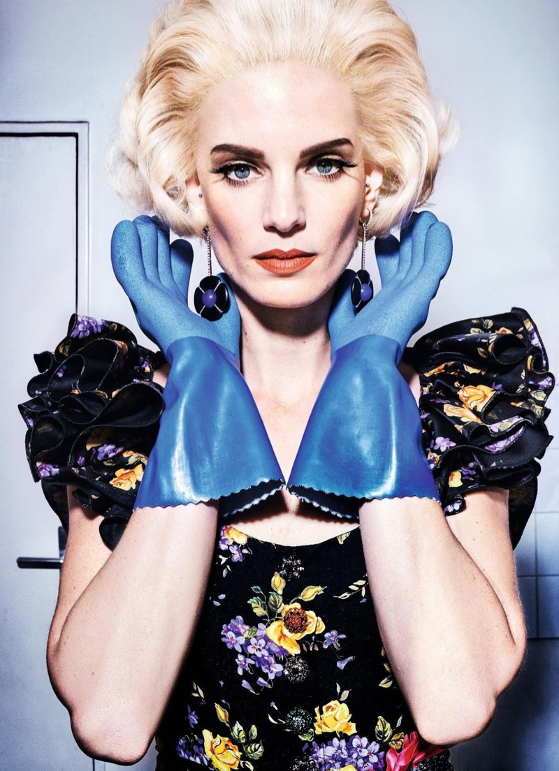 Model Iris Strubegger wears 50's inspired hairstyle with short curls. Black floral print dress by Dolce & Gabbana.
