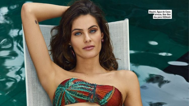 Isabeli Fontana lounges in Agua de Coco bikini and Bee Bee Jour for OQVestir earrings