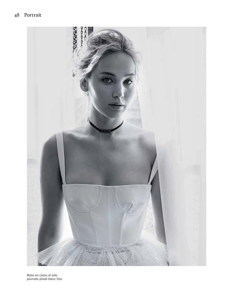 Actress Jennifer Lawrence poses in Dior dress with tulle skirt