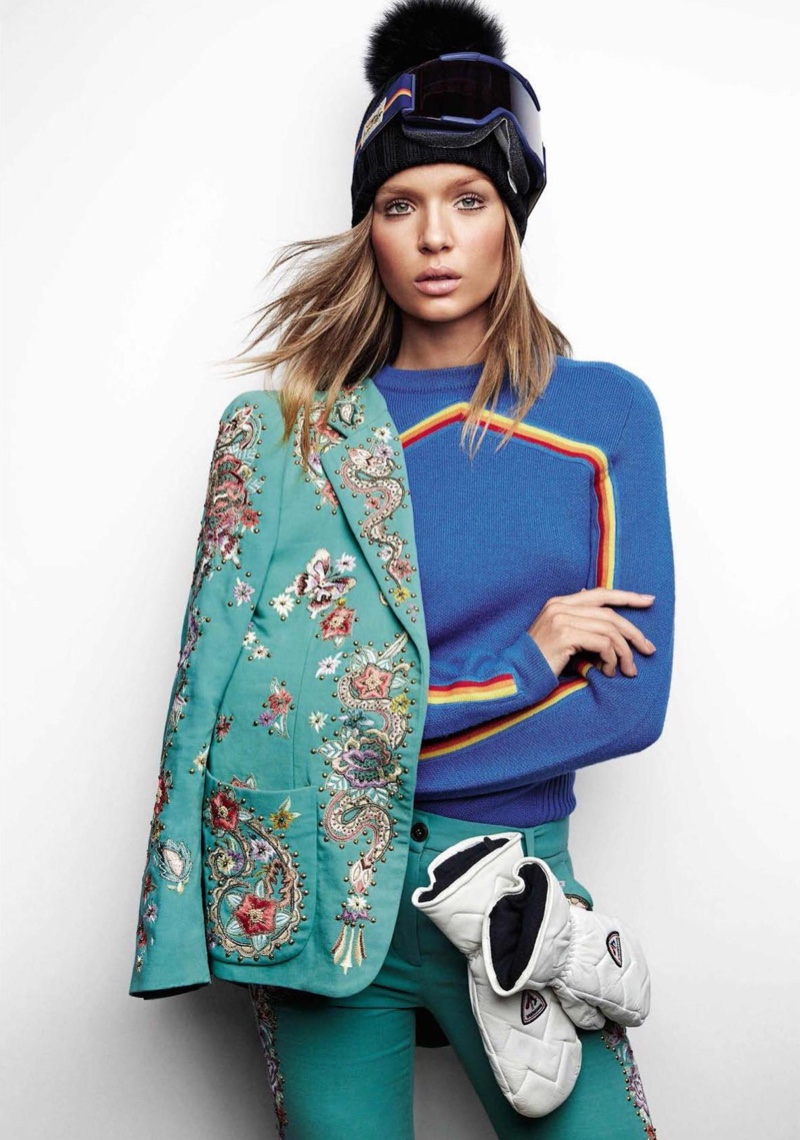 Josephine Skriver poses in Roberto Cavalli jacket and embroidered pants with Carven wool sweater