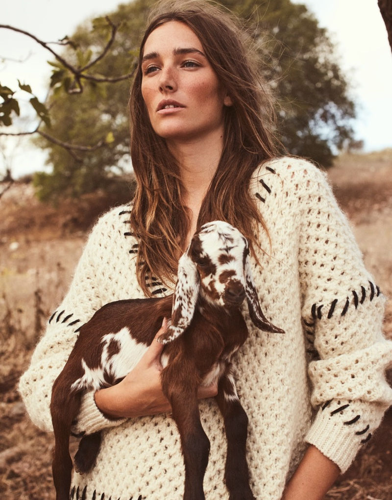 Posing with a goat, Josephine le Tutour wears Isabel Marant sweater