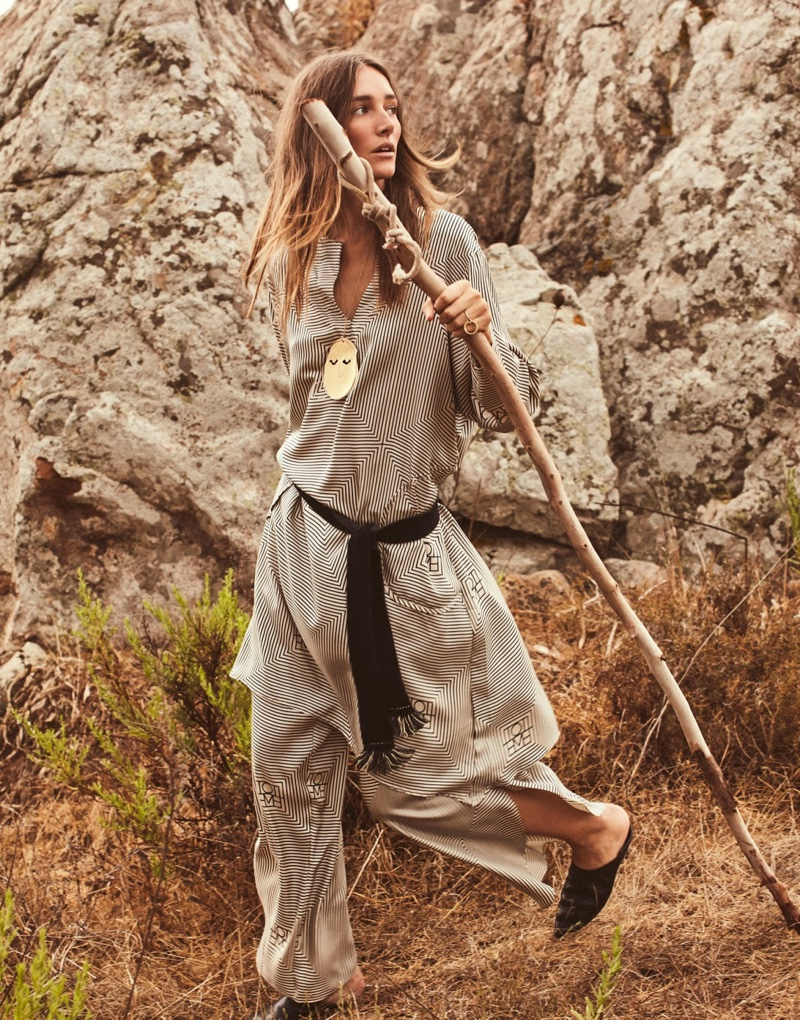 Taking a trek, Josephine le Tutour wears Totême tunic and pants with Vince shoes