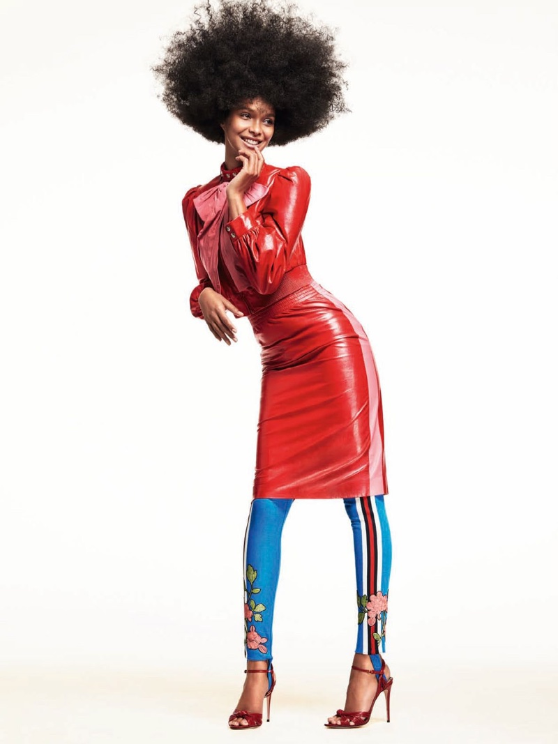 Rocking an afro, Lais Ribeiro models Gucci jacket and skirt