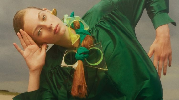Wearing green, Lauren de Graaf models Ashish top and trousers