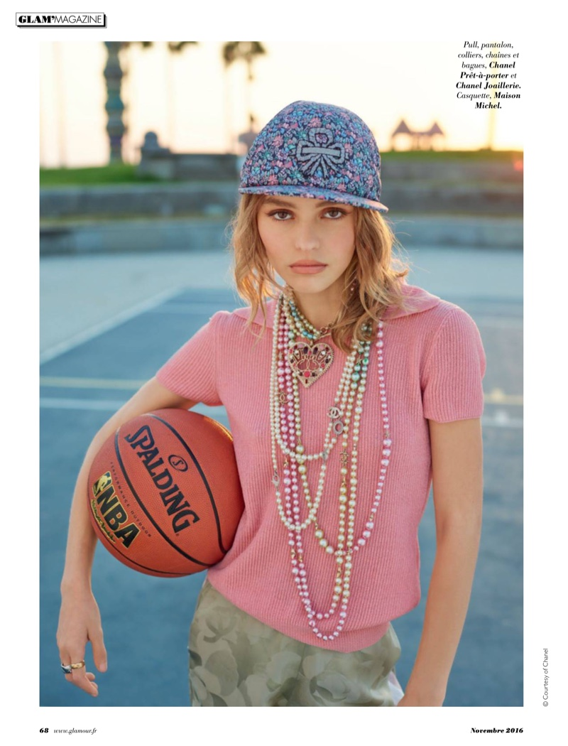 Keeping it casual, Lily-Rose Depp models Chanel sweater, pants and jewelry with Maison Michel hat