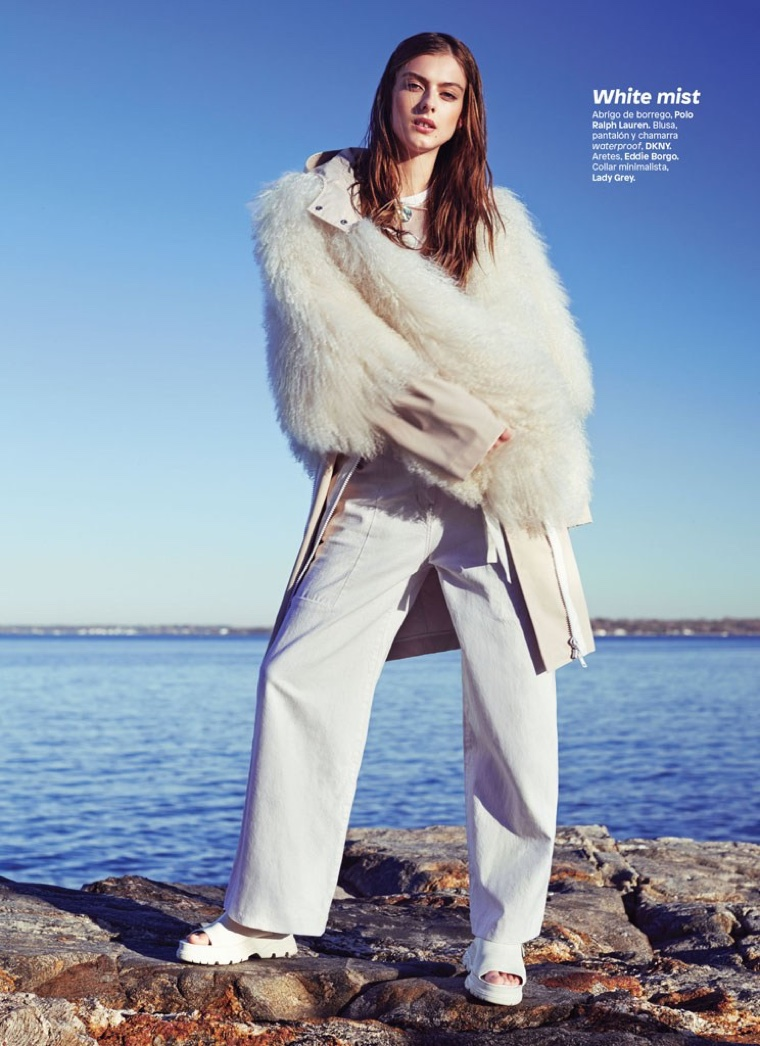 Wearing all white, Lone Praesto models Polo Ralph Lauren jacket with DKNY pants and coat