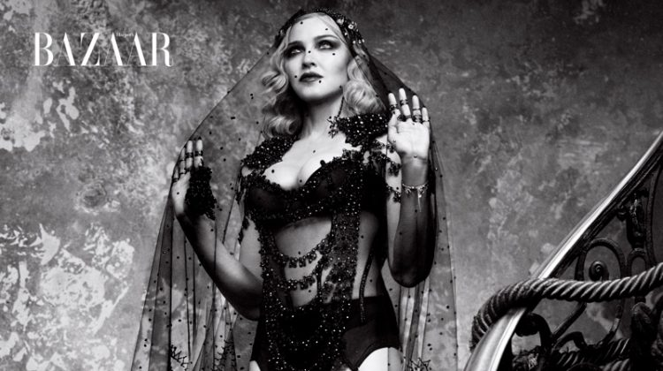 Photographed in black and white, Madonna poses in Gucci cape with La Perla bodice