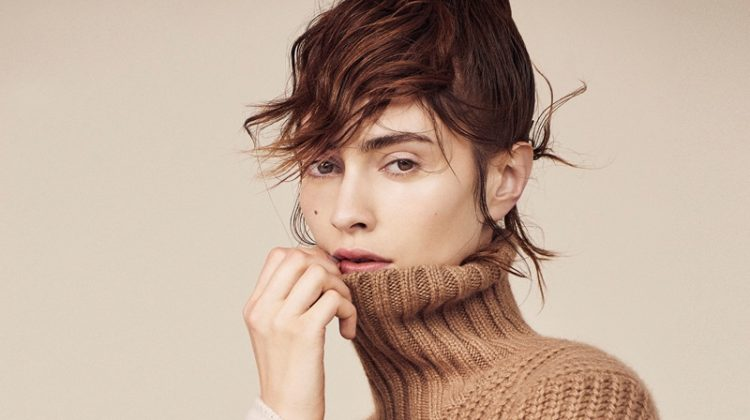 Model Marine Deleeuw poses in Michael Kors Collection sweater with Tibi top