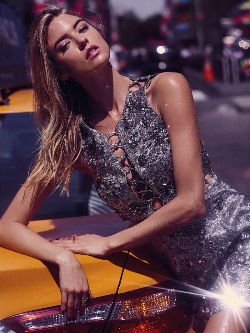 Posing on a car, Martha Hunt wears embellished Michael Kors Collection dress