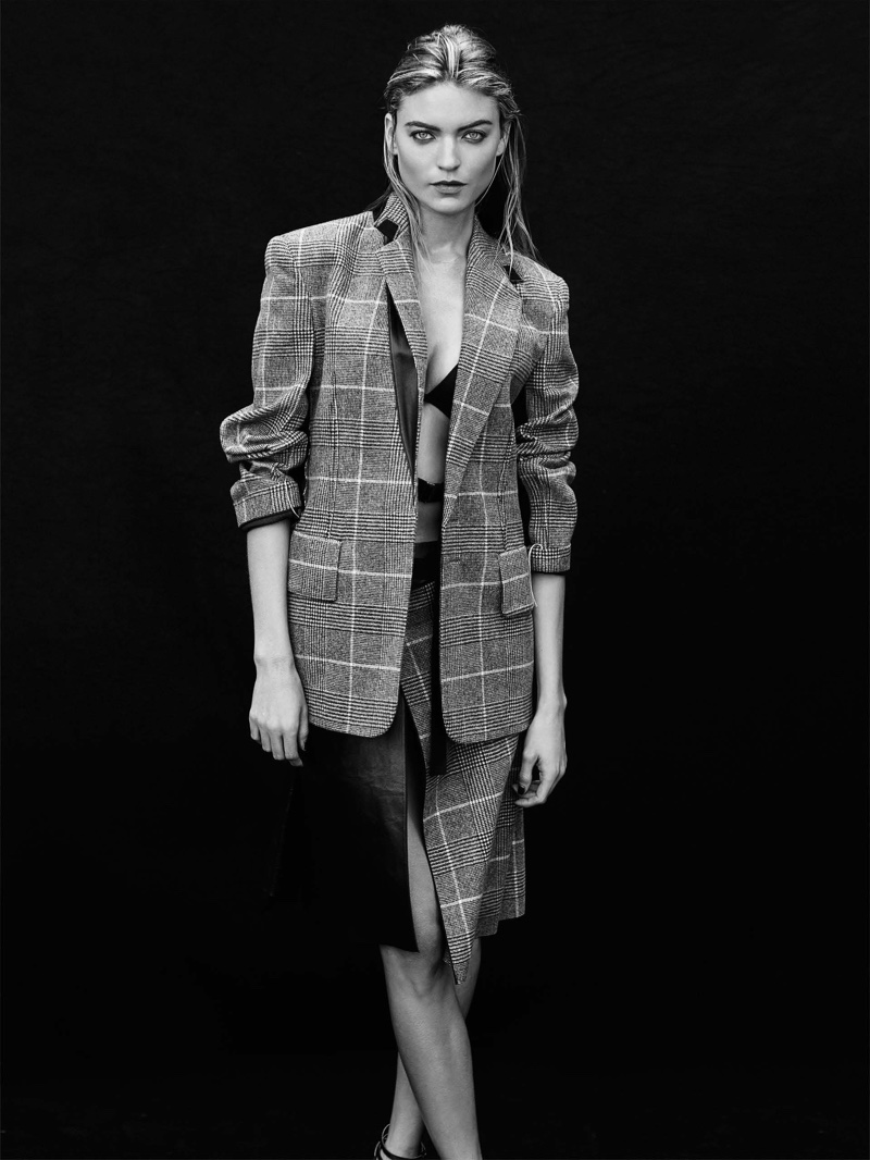Martha Hunt wears plaid jacket and skirt