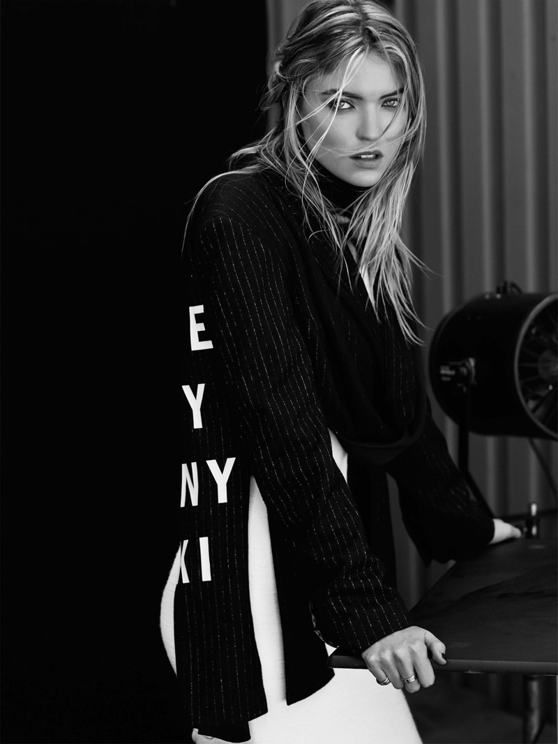 Martha Hunt wears DKNY top and Loewe bottoms