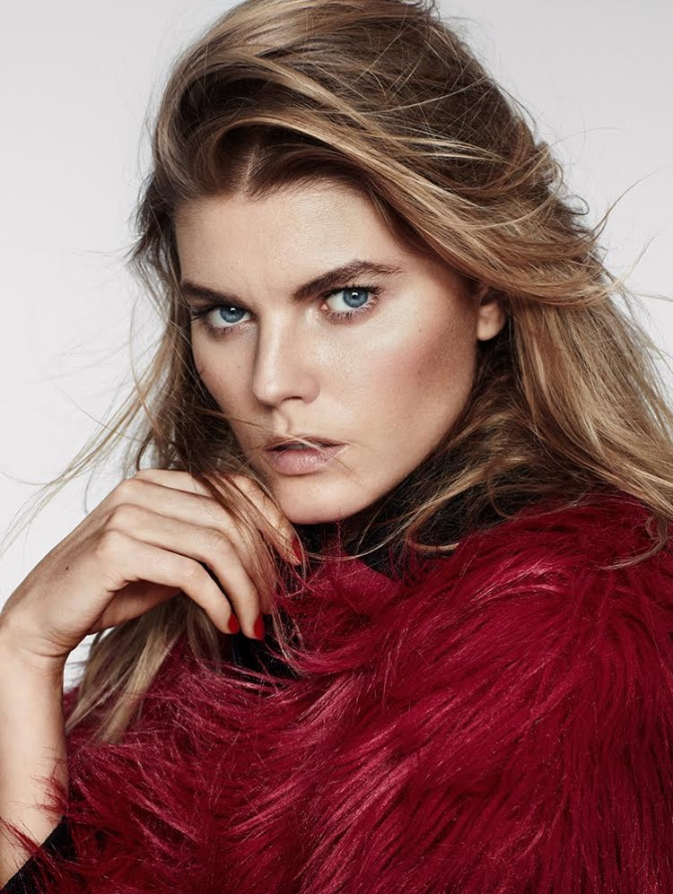 Getting her closeup, the model wears Gucci fur coat