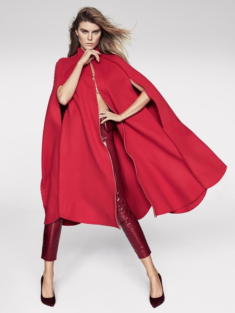 Covering up, Maryna Linchuk wears red cape with cropped trousers