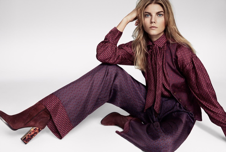Model Maryna Linchuk poses in Trussardi top, pants, vest and boots