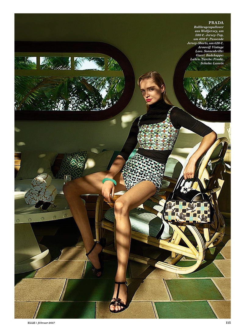 Maud Welzen models Prada sweater, top, shorts and bag. Sunglasses by Gucci and shoes by Lanvin.