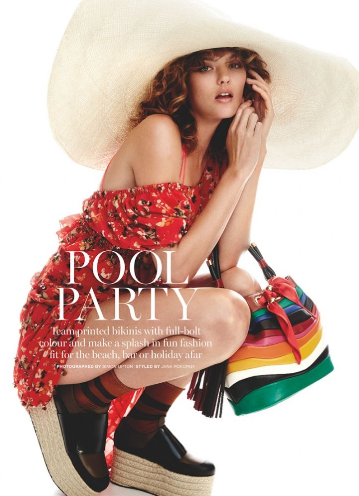 Montana Cox models Dior dress with Mikoh swimsuit and Salvatore Ferragamo bag