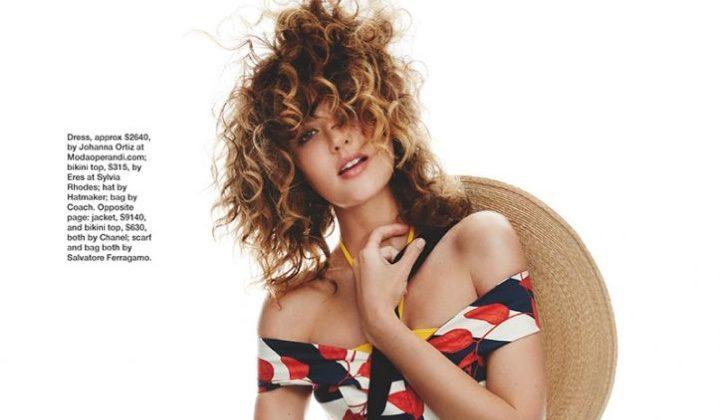 Embracing print, Montana Cox wears Johanna Ortiz dress, Eres bikini top and Coach bag