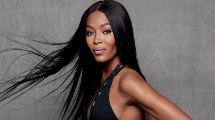 Naomi Campbell poses in little black dress with grommet details
