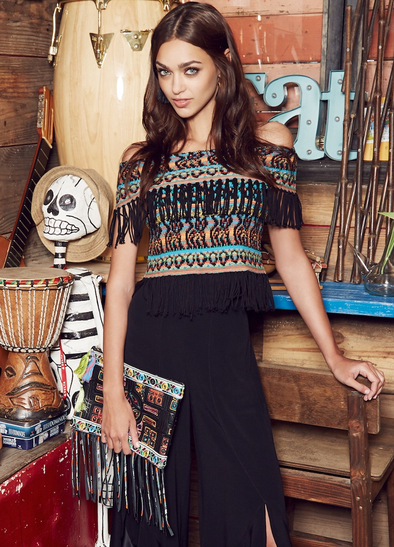 Model Zhenya Katava wears fringed top and bag in Nicole Miller's spring 2017 campaign