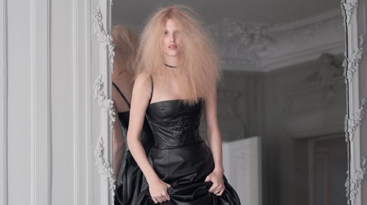 Model Niki Trefilova poses in Dior leather dress with quilted detail