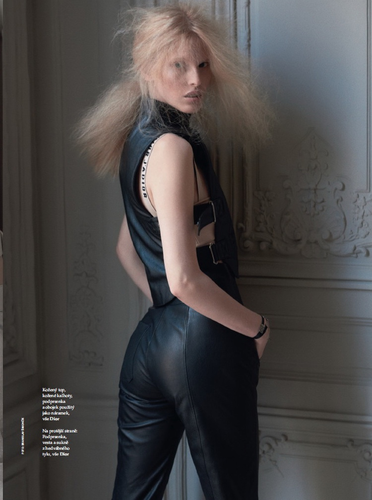 The model wears Dior black leather top and pants