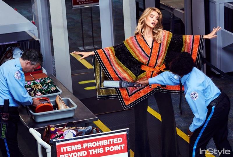 Posing at the airport, Rosie Huntington-Whiteley models Balmain beaded poncho and pants