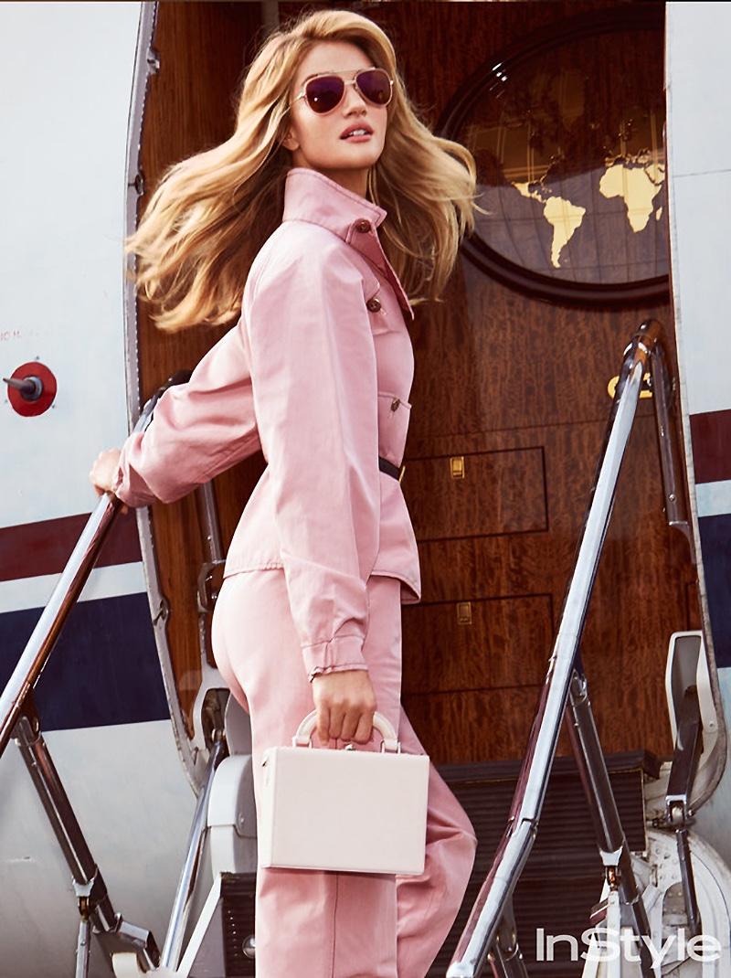 Looking pretty in pink, Rosie Huntington-Whiteley models Bottega Veneta jacket and pants with Bertoni 1941 bag