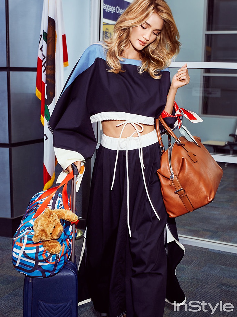 Walking through the airport, Rosie Huntington-Whiteley wears Chloe top and skirt