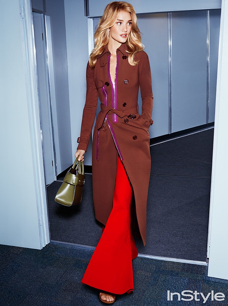 Taking a stroll, Rosie Huntington-Whiteley models Givenchy coat, bag and trousers with Jimmy Choo sandals