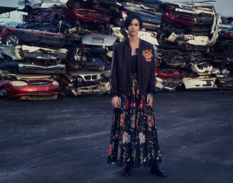 Posing in a junkyard, Ruby Rose wears Roberto Cavalli jacket, The Row top, Adam Lippes skirt and Jimmy Choo boots