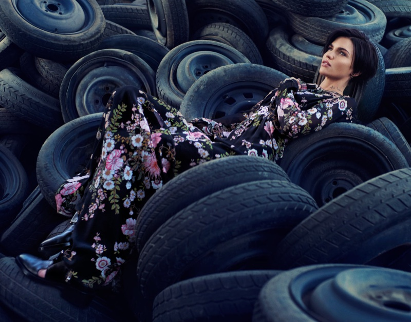 Posing in a bed of tires, Ruby Rose wears Giambattista Valli floral print dress and 3.1 Phillip Lim boots