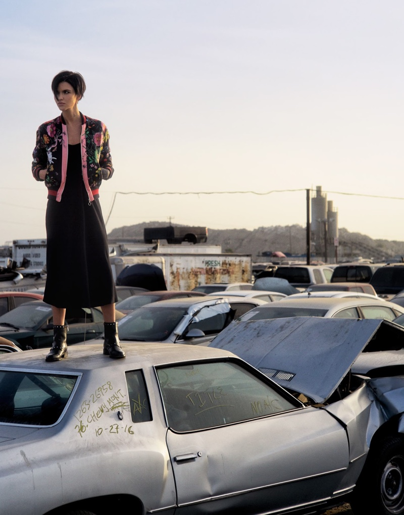 Standing on a car, Ruby Rose wears Gucci jacket, The Row dress and Jimmy Choo boots