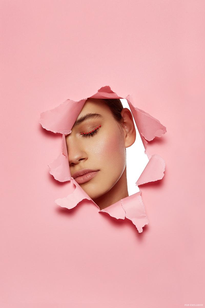 Underneath the pink, Sophia Tatum wears romantic makeup looks. Photo: Beth Sternbaum