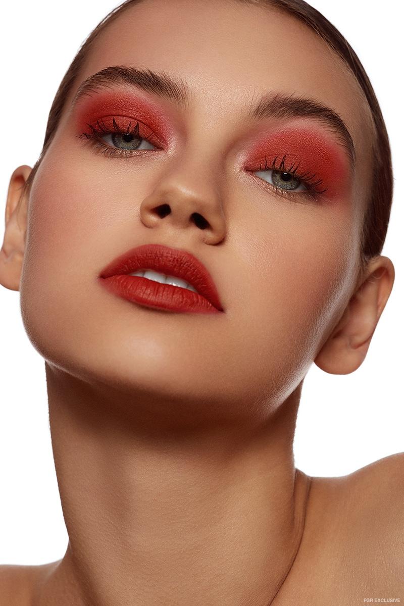 Sophia Tatum wears bold red eyeshadow and lipstick shade. Photo: Beth Sternbaum