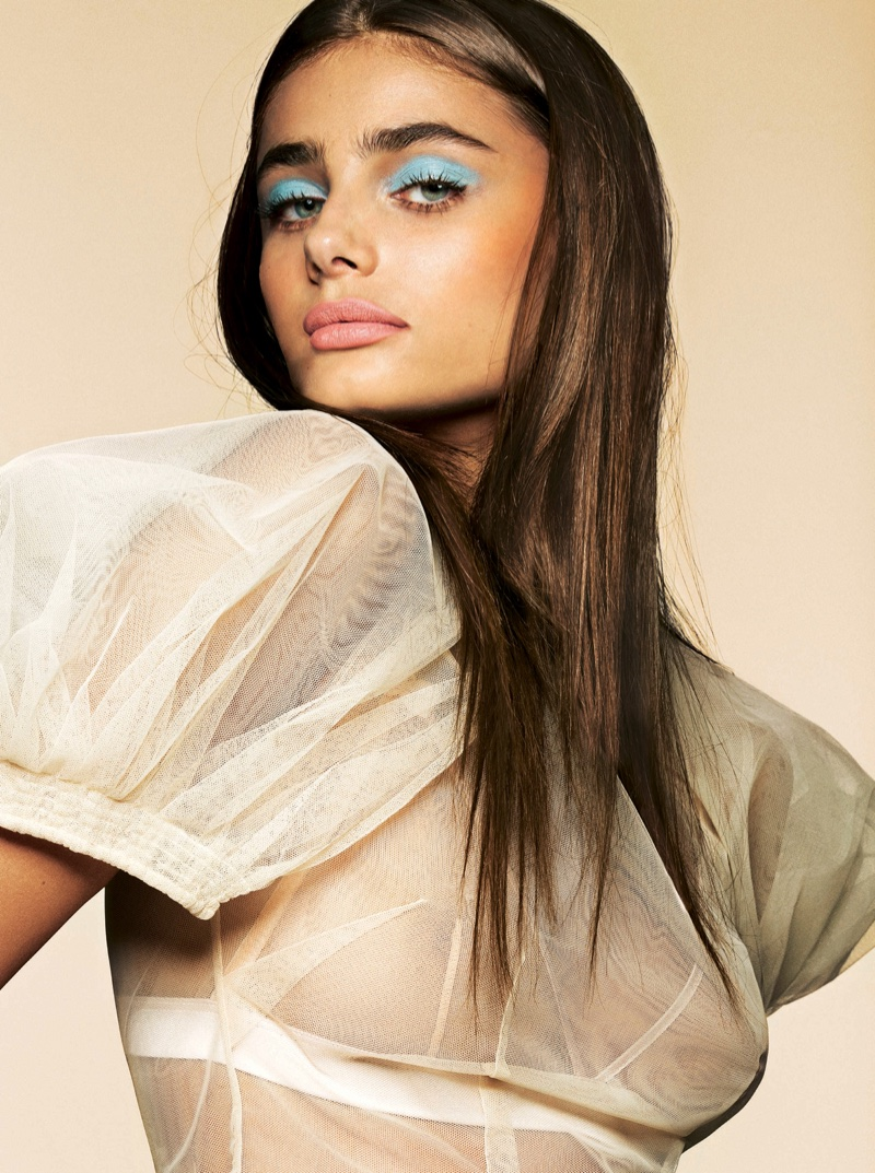 Model Taylor Hill wears blue eyeshadow and pink lipstick shade