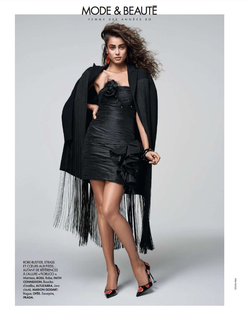 Wearing black, Taylor Hill poses in BOSS coat, Faith Connexion dress and Altuzarra pumps