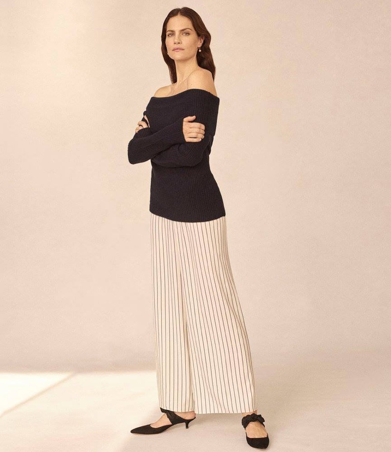 The Row Agneta Rib-Knit Off-the-Shoulder Sweater and Lala Striped Silk Pants. Sidney Garber Ball-Dop Earrings.