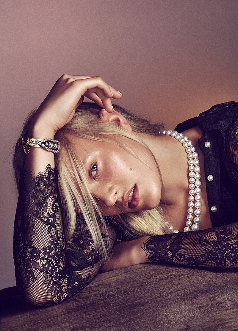 Vivien Wysocki wears lace top with pearl necklace and sparkling cuff