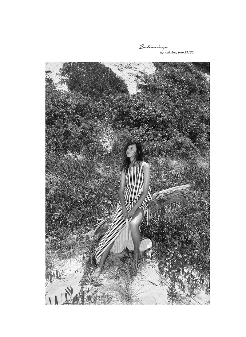 Photographed in black and white, the model wears Balenciaga striped top and skirt