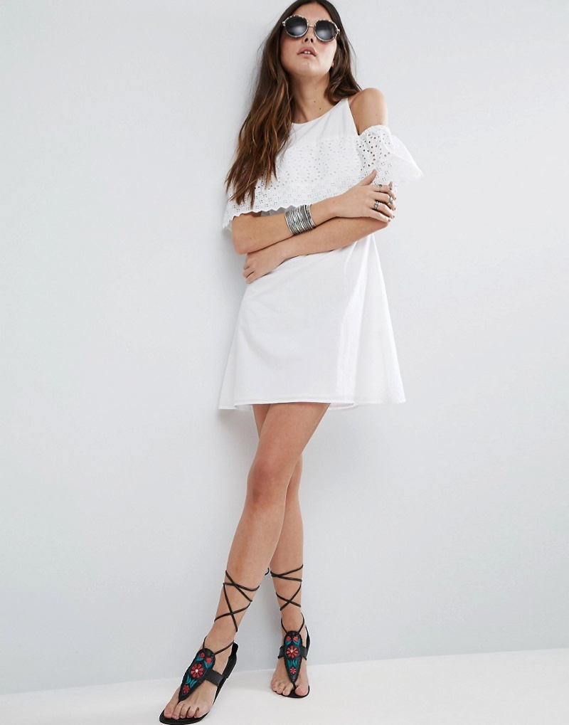The Broderie Cold-Shoulder Sundress has a relaxed shape