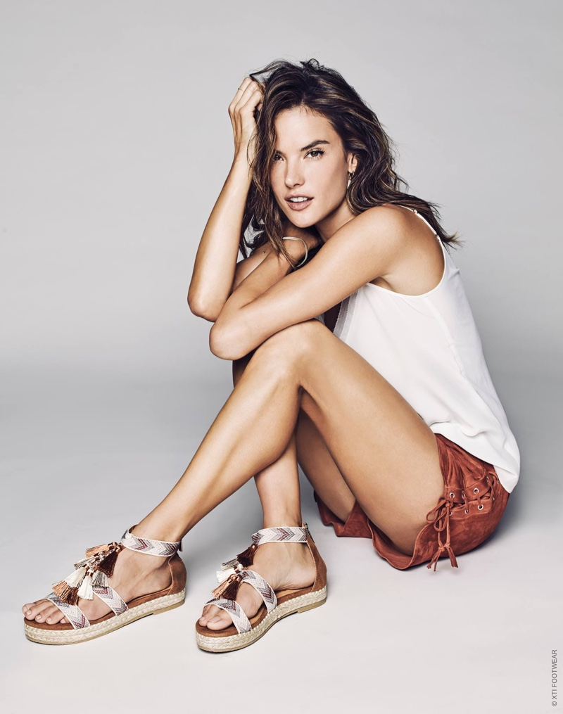 Model Alessandra Ambrosio wears tasseled sandals in XTI Shoes' spring 2017 campaign