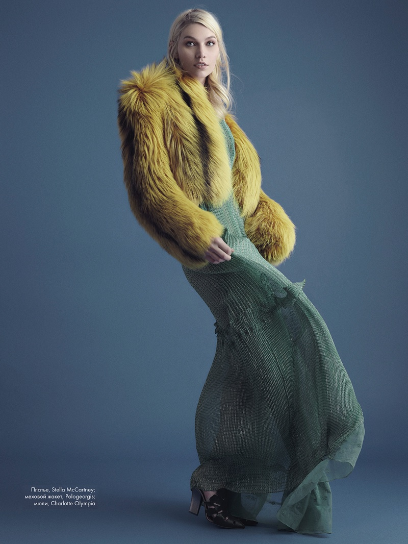 Model Aline Weber poses in Pologeorgis fur jacket, Stella McCartney dress and Charlotte Olympia shoes